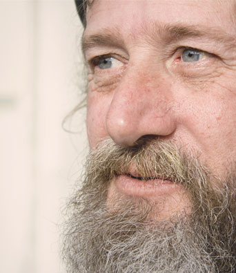 Close up of retired bearded man's face