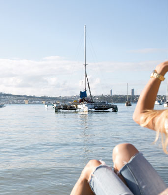 Girl looking at the view across Waitemata harbour