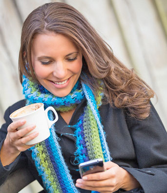 woman-with-mobile-and-coffee