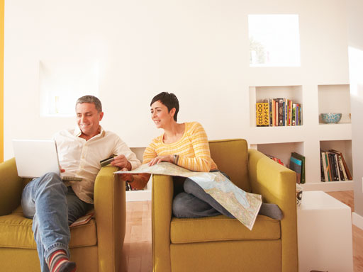 Couple sitting on sofa discussing insurance plans