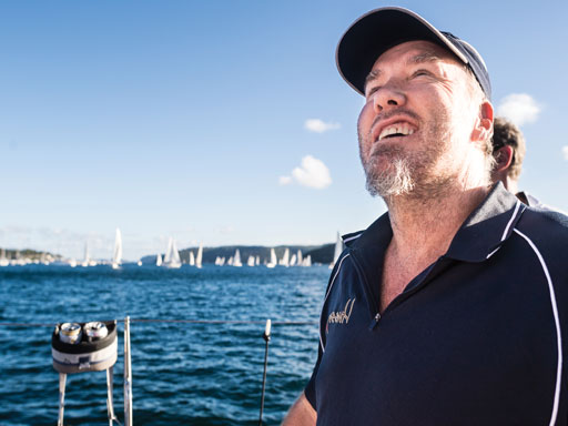 Man taking control of sailing boat