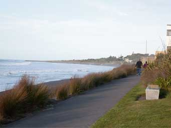 Beachfront pathway with couple in background